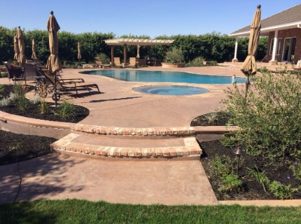 Picture of a concrete pool deck done by a concrete contractor in Modesto, California