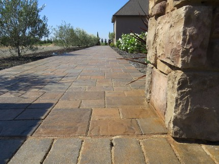 picture of a stacked stone pillar and stamped concrete patio in modesto california