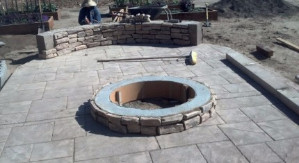 fireplace being built and stacked stone wall that is being built with a stamped concrete patio in Modesto, California